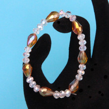 BS149-2 Стеклянный браслет с гранёнными бусинами 6-8мм, цвет золотой