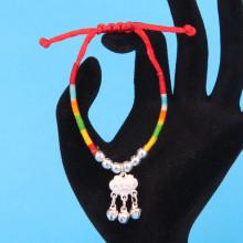 BS222 Браслет из красного шнура и разноцветных нитей Замок Долголетия